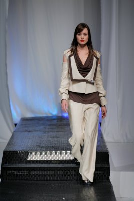 Model wearing white Abigail McCannon design
