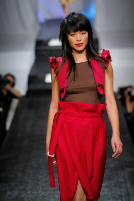 Model wearing red Abigail McCannon design