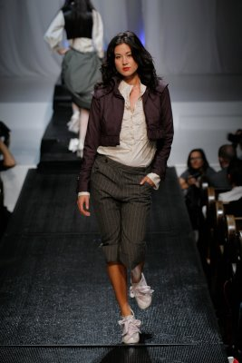 Model in short jacket and grey pants by Alexandra Armstrong Igleheart