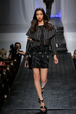 Model in black mini skirt by Alix Hadley