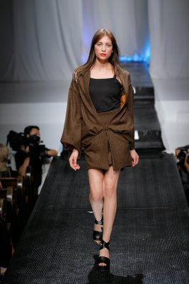 Model in brown mini skirt by Alix Hadley