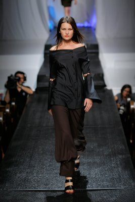 Model in black top and brown pants by Alix Hadley