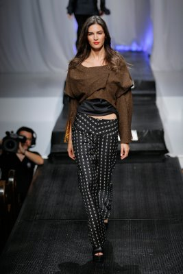 Model in polka dot pants and brown top by Alix Hadley