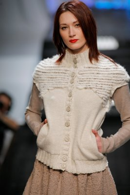 Model wearing white knit top by Elieza S. Perez