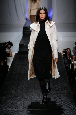 Model wearing white wool trenchcoat