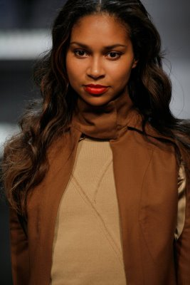 Close up of model wearing brown outfit