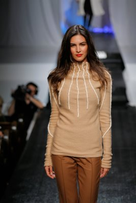 Model wearing brown top and brown pants