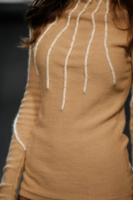 Close up of model wearing brown top