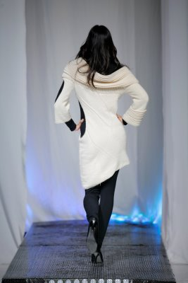 Back of model wearing white knitwear by Olga Mashkova -Henry