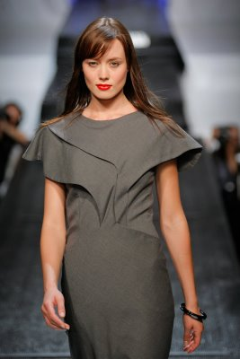 Model wearing grey Anna Arguello dress