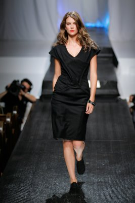 Walking the runway in a black Anna Arguello creation
