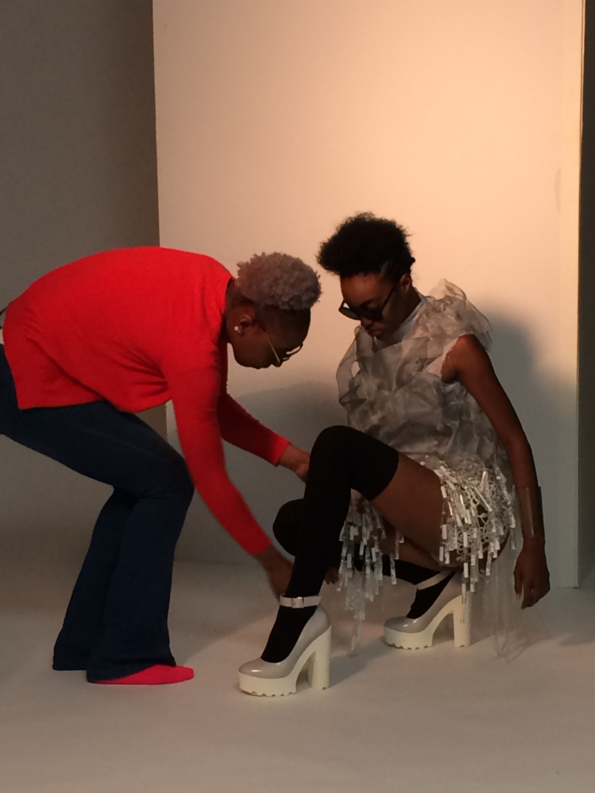 A student styling a model during the photo shoot. Photo courtesy of Bethany Meuleners.