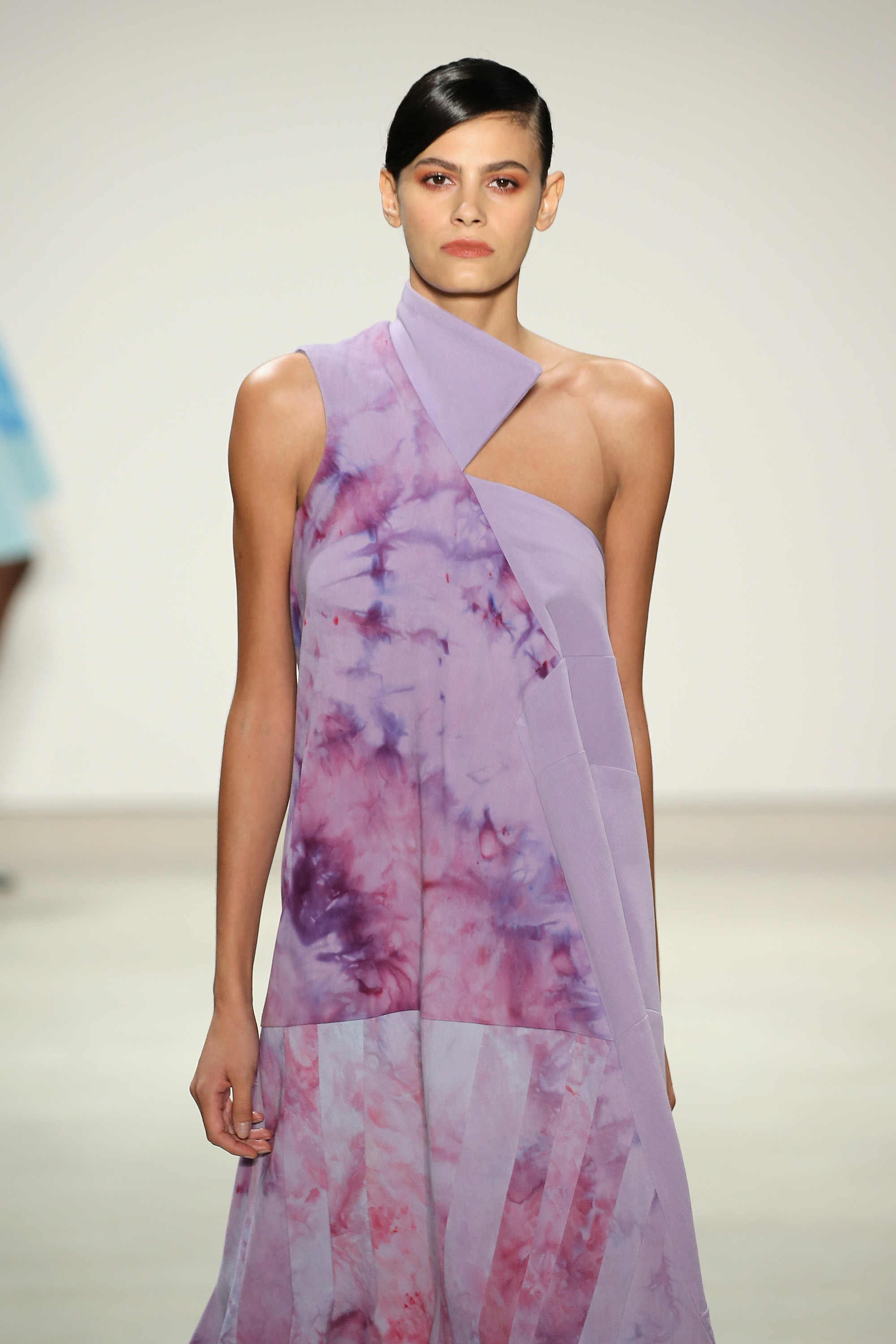 Denim A-line dress splashed in orchid with exaggerated trumpet hem, Courtesy of Supima