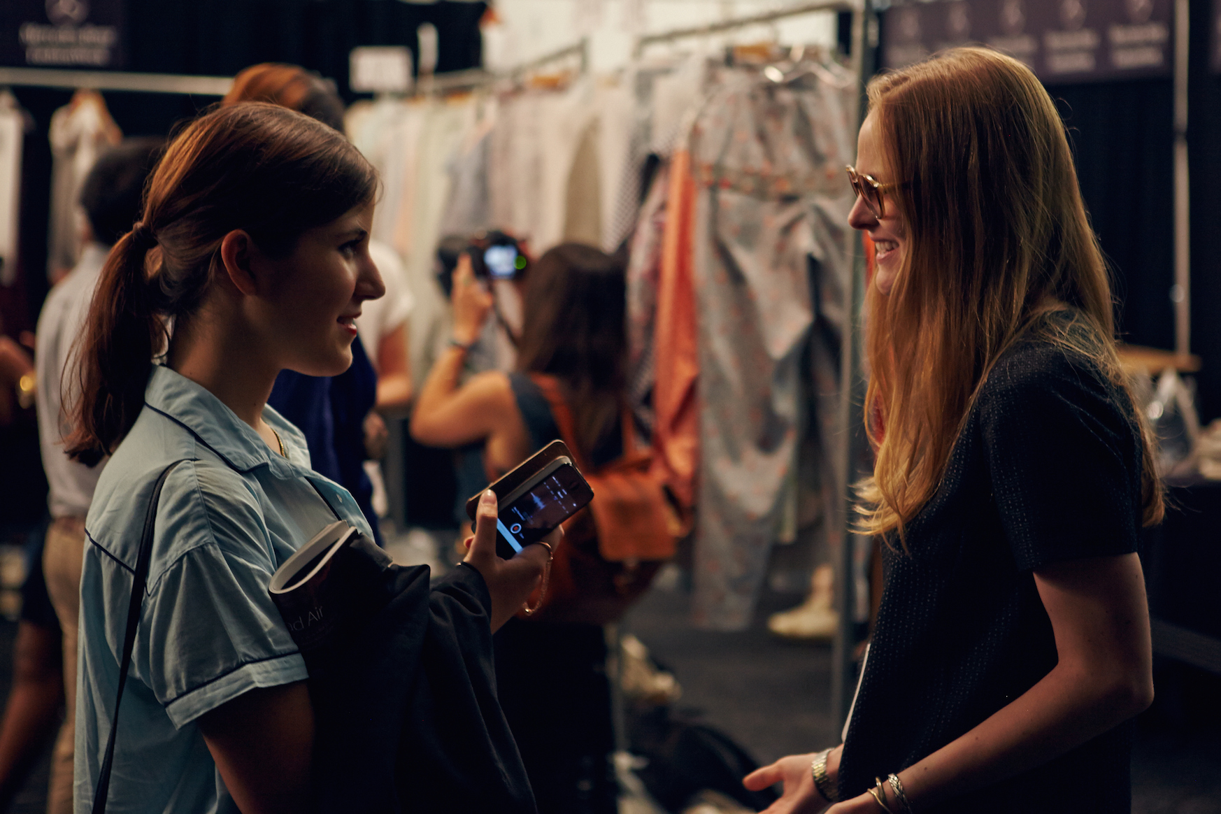 Alex Suarez backstage at the Academy of Art University New York Fashion Week Spring 2015 show, interviewing designer Madison Detro