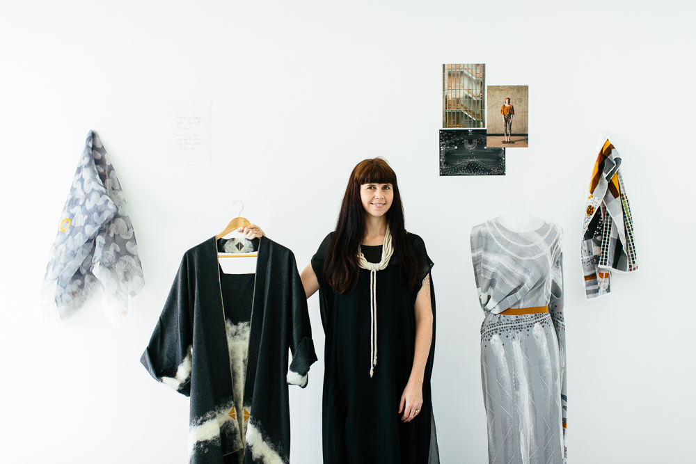 Holly Mcquillan poses with some of her zero waste garments. Image courtesy: PIVOT.