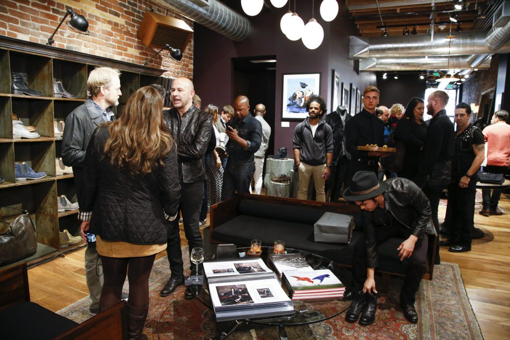 Patrons shop at a John Varvatos clothing store on October 1, 2016 in San Francisco, California. (Photo by Kimberly White/Getty Images for John Varvatos)