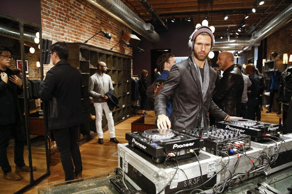 Guests shop to the musical stylings of DJ Andrés Sette Arruza. (Photo by Kimberly White/Getty Images for John Varvatos)