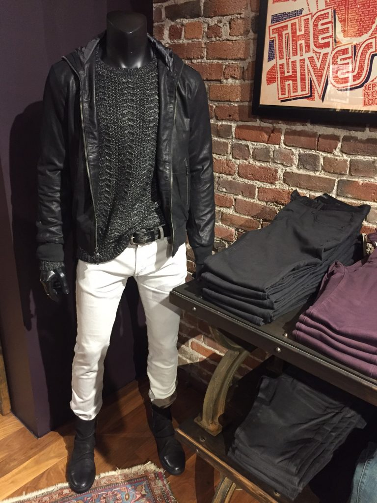 A woolen sweater and leather jacket paired with fitted white denim and leather boots show a true representation of the classic John Varvatos style. Image Source: Fashion school Daily