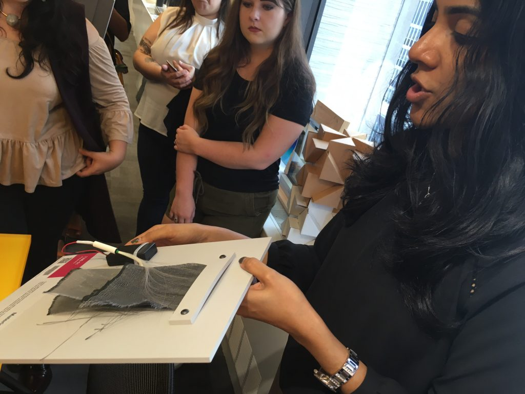 Gayatri Keskar, Material Scientist at Material ConneXion- Showing the students a Flexible, lightweight, translucent Fiber Optic Fabric from LumiGram SARL . Image Source: Iliana Ricketts