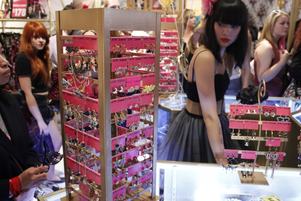 An employee manning the jewelry counter