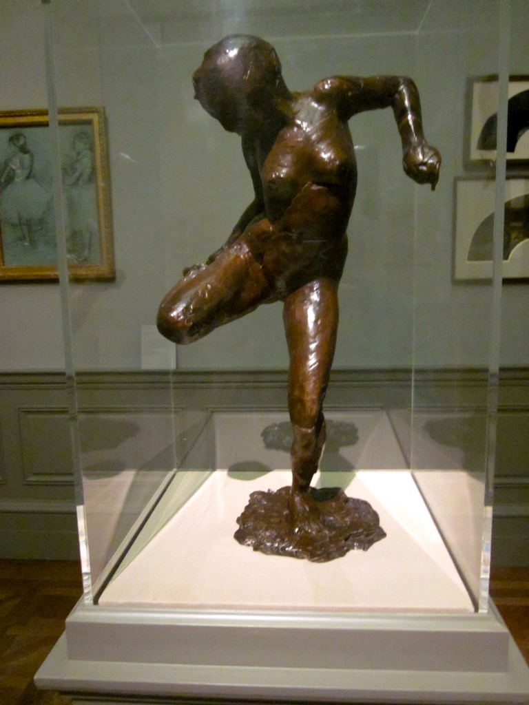 Edgar Degas (1834 - 1917) Dancer looking at the sole of her right foot.