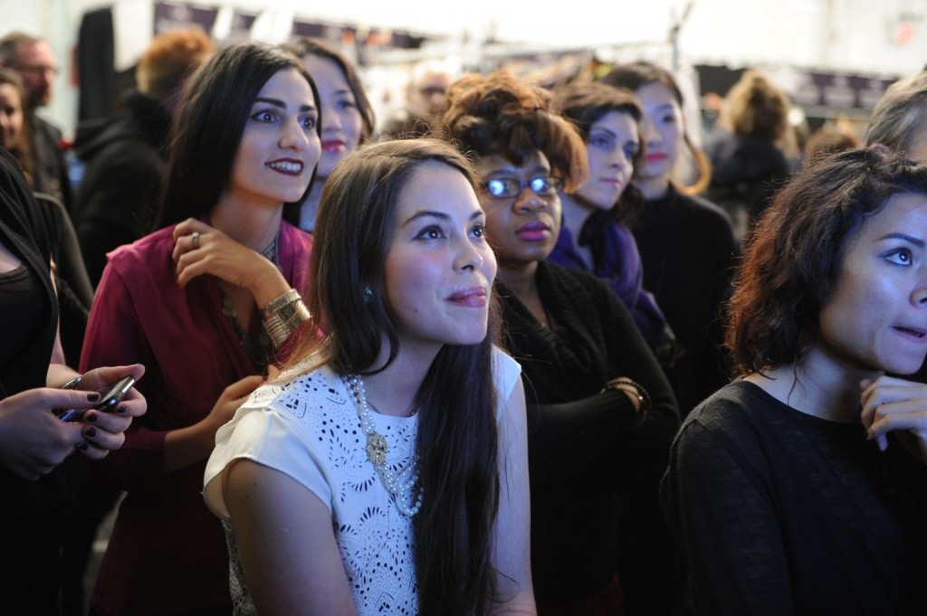 Designers watching and waiting backstage as their  collections come down the runway.   Image: David Dooley