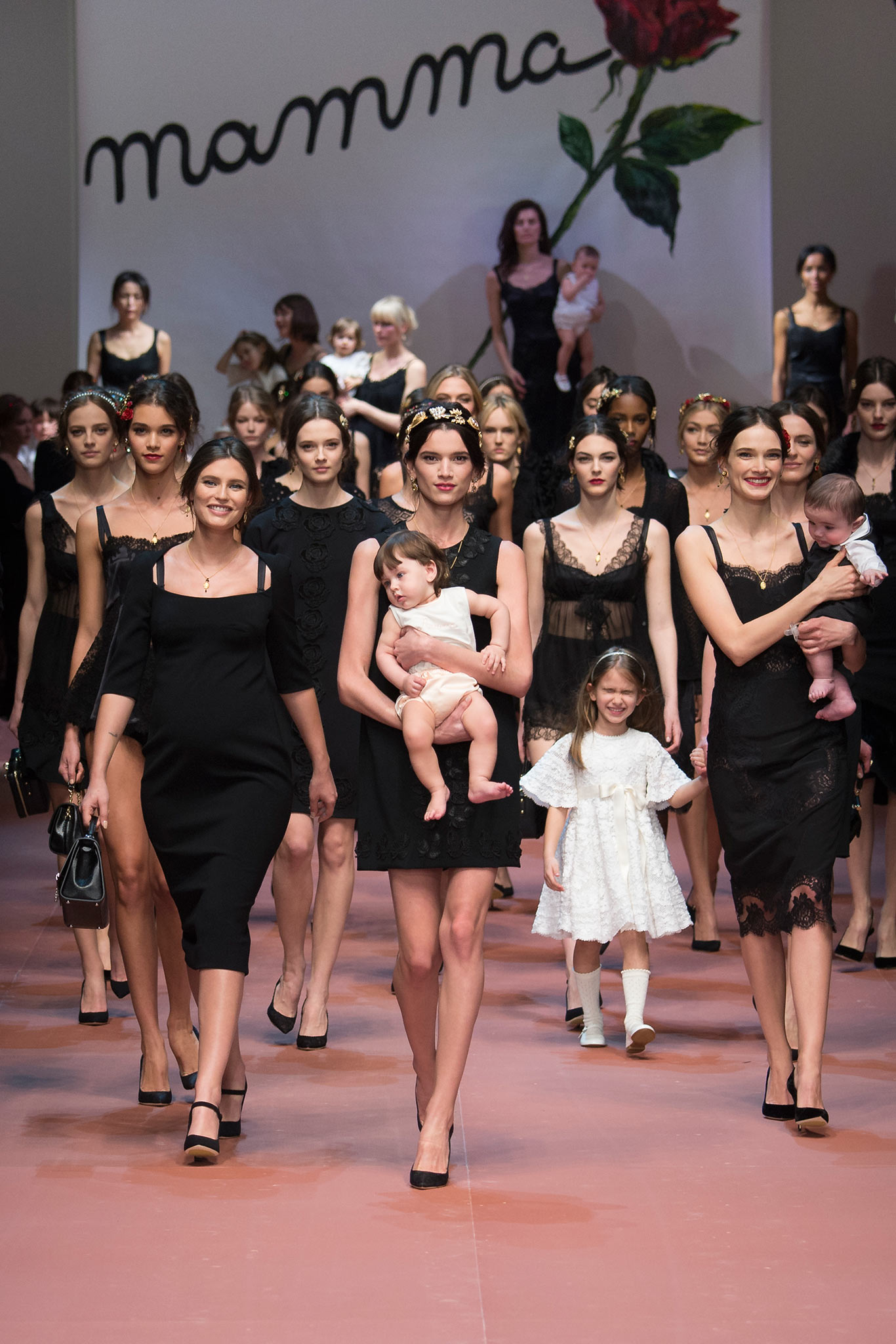 Dozens of models wearing Dolce & Gabbana In an ode to all the mothers around the world