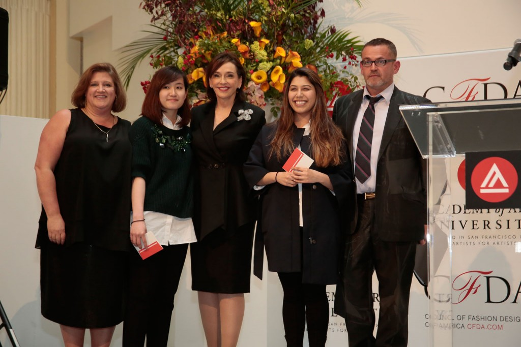 Lisa Smilor, Executive Director of the Council of Fashion Designers of America (CFDA), presenting BFA Fashion Design students Anh Phuong Thy Do and Pitzy Villagomez Ortega with CFDA Scholarship Awards along with Academy of Art University President Elisa Stephens and Academy of Art University School of Fashion Executive Director Simon Ungless