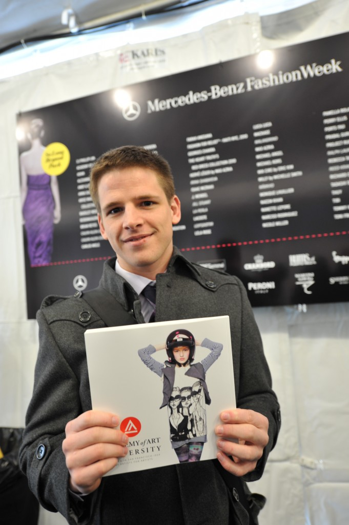 Danny Roberts with a copy of 180 Magazine Volume 3, the cover of which was graced by Roberts' collaboration with Forever2